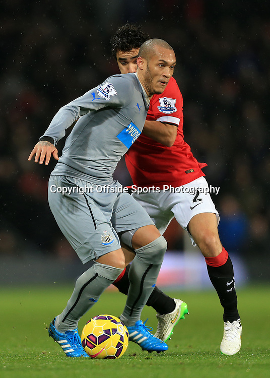 26th December 2014 - Barclays Premier League - Manchester United v Newcastle United - Yoan Gouffran of Newcastle battles with Rafael Da Silva of Man Utd - Photo: Simon Stacpoole / Offside.