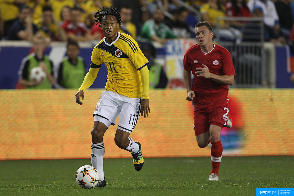 Juan Cuadrado, Colombia, in action during the Colombia Vs Canada friendly international football match at Red Bull Arena, Harrison, New Jersey. USA. 14th October 2014. Photo Tim Clayton