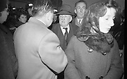 Mr. Stephen Behan, father of the dead playright, Brendan, recieves sympathy from friends as he enters the Church of the Sacred Heart, Donnybrook, behind his son's coffin..21.03.1964