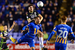 Ryan Sweeney of Bristol Rovers challenges for a header with Carlton Morris of Shrewsbury Town - Mandatory by-line: Dougie Allward/JMP - 17/10/2017 - FOOTBALL - Greenhous Meadow - Shrewsbury, England - Shrewsbury Town v Bristol Rovers - Sky Bet League One