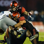 18 November 2017:  The San Diego State football team hosts Nevada Saturday night. San Diego State Aztecs linebacker Ronley Lakalaka (39) helps to bring down Nevada Wolf Pack running back Kelton Moore (23) in the third quarter. The Aztecs beat the Wolf Pack 42-23 at SDCCU stadium. <br /> www.sdsuaztecphotos.com