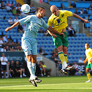Picture by Alex Broadway/Focus Images Ltd.  07905 628187.30/7/11.Richard Wood of Coventry City and Steve Morison of Norwich City during a pre season friendly at The Ricoh Arena, Coventry.