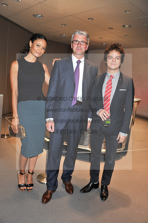 Left to right, THANDIE NEWTON, RUPERT STADLER chairman of Audi and JAMIE CULLUM at the Global Launch of Audi's first Digital Showroom, 74-75 Piccadilly, London on 16th July 2012.