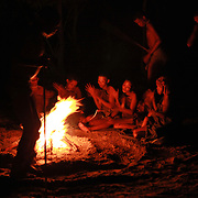 Bushmen dance by campsite fire in the Kalahari Desert in Botswana.