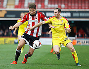 Brentford defender Harlee Dean and Rotherham United midfielder Aidan White go shoulder to shoulder during the Sky Bet Championship match between Brentford and Rotherham United at Griffin Park, London, England on 17 October 2015. Photo by Andy Walter.