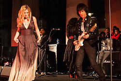 Covent Garden, London, October 30th 2014. Multi-platinum selling artist Joss Stone performs two numbers with legendary guitarist Jeff Beck as part of the events in Covent Garden where London Poppy Day events were held as the Royal British Legion raises funds, with over £1 million expected to be raised. PICTURED: Joss Stone, Jeff Beck