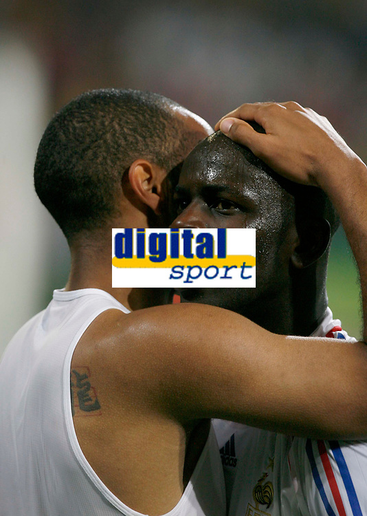 Photo: Glyn Thomas.<br />Spain v France. Round 2, FIFA World Cup 2006. 27/06/2006.<br /> France's William Gallas (R) celebrates with Thierry Henry at the final whistle.
