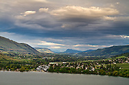 View of the Coldstream Valley looking over Kalamalka Lake towards the Camels Hump and the Monashee Mountains from Vernon, British Columbia, Canada