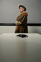 King Henry VIII standing in conference room