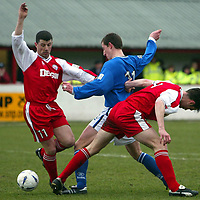Brechin v St Johnstone...27.03.04<br />Chris Hay forces his way between Ally Mitchell and Andy Dowie to open the scoring for St Johnstone<br /><br />Picture by Graeme Hart.<br />Copyright Perthshire Picture Agency<br />Tel: 01738 623350  Mobile: 07990 594431