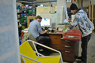 An employee and a casual day worker in the loading area of Worth a Second Look, a second hand store in Kitchener, Ontario, Canada. Both men take part in Job Cafe, a casual work program offered by The Working Centre.