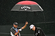 Jul 29, 2016; Springfield, NJ, USA; Brad Ott (right) and his caddie Chris Jones (left) putt on the practice green during the second round of the 2016 PGA Championship golf tournament at Baltusrol GC - Lower Course. Mandatory Credit: Eric Sucar-USA TODAY Sports