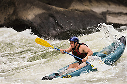 Matt Anderson runs the Fayette Station Rapids on the New River near the New River Gorge Bridge in the New River Gorge National River, West Virginia.