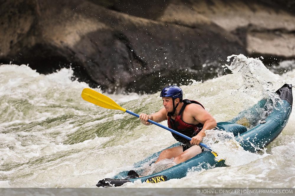 Matt Anderson runs the Fayette Station Rapids on the New River near the New River Gorge Bridge in the New River Gorge National River, West Virginia.
