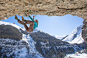 "Mountain guide and mixed climbing champion Dawn Glanc climbing ""Pull the Trigger Tigger"" D11 in the ""Hall of Justice"" San Juan Mountains."