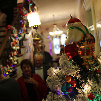 Visitors of Traci Kent's home, the Gregg-Hamilton House, look at the array of Christmas decorations.