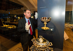 Pictured: Dr Godfrey Evans, Principal Curator of European Applied Art, checks  the  Hamilton-Rothschild Tazza display<br /> <br /> The National Museum of Scotland will launch ten new galleries on 8 July following a £14.1 million redevelopment in their 150th year.  <br /> <br /> Ger Harley | EEm 5 July 2016