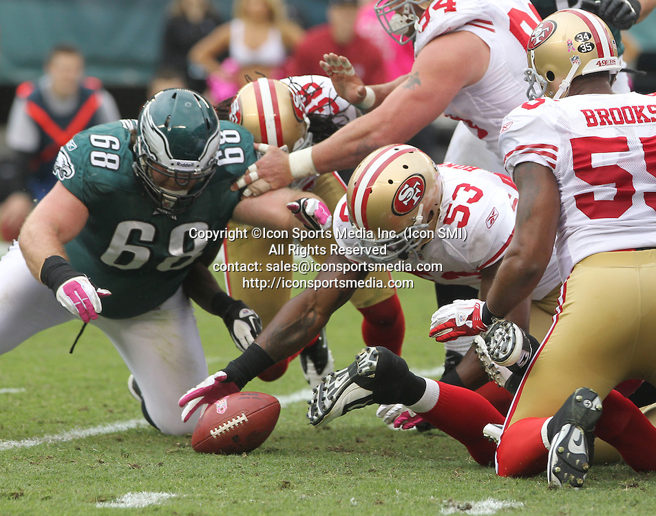 Oct. 2, 2011 - Philadelphia, PA, USA - NaVorro Bowman, right, of the 49ers recovers a fumble by the Eagles' Ronnie Brown in the 2nd quarter. The San Francisco 49ers defeated the Philadelphia Eagles, 24-23, at Lincoln Financial Field in Philadelphia, Pennsylvania, Sunday, October 2, 2011