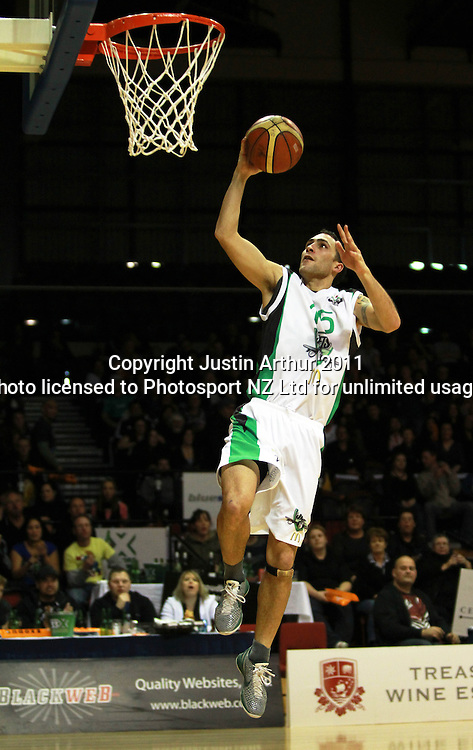 Jets Matt Huna goes up for a dunk. NBL- Wellington Saints v Manawatu Jets at TSB Bank Arena Wellington, New Zealand on Friday 24 June 2011. Photo: Justin Arthur/ photosport.co.nz