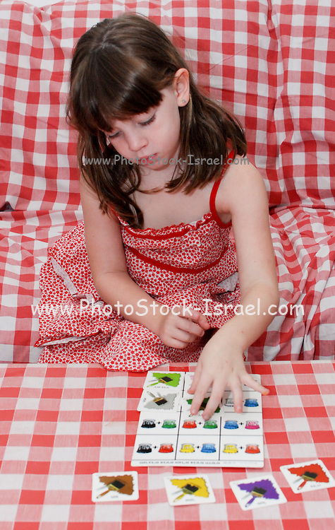 Young preschool girl of 5 Playing with a colour matching game