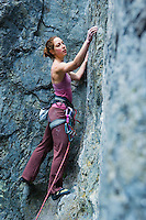 A portrait of a late 20's Caucasian Red Headed woman rock climbing ..Model Release: 20070608_MR_A