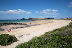 "© Licensed to London News Pictures. 11/05/2020. Newquay, UK. Constantine beach on the North coast of Cornwall is empty, the day after British Prime Minister Boris Johnson announced a 'road map' to lift lockdown restrictions due to Covid-19, (Coronavirus). A rise in ""staycations"" - the concept of holidaying in your home country rather than travelling abroad - is expected, with many visitors planning to visit Cornwall. However, an ongoing campaign titled ""#ComeBackLater"" is trying to persuade tourists not to visit the county until it is safe to do so. Photo credit : Tom Nicholson/LNP"