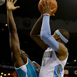 October 29, 2010; New Orleans, LA, USA; Denver Nuggets small forward Carmelo Anthony (15) shoots over New Orleans Hornets center Emeka Okafor (50) during the first half at the New Orleans Arena.  Mandatory Credit: Derick E. Hingle