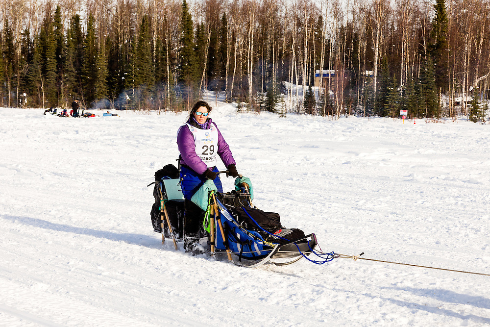 Musher Karin Hendrickson competing in the 41st Iditarod Trail Sled Dog Race on Long Lake after leaving the Willow Lake area at the restart in Southcentral Alaska.  Afternoon.