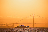 Tour boat and Golden Gate Bridge at sunet, San Franciso, California