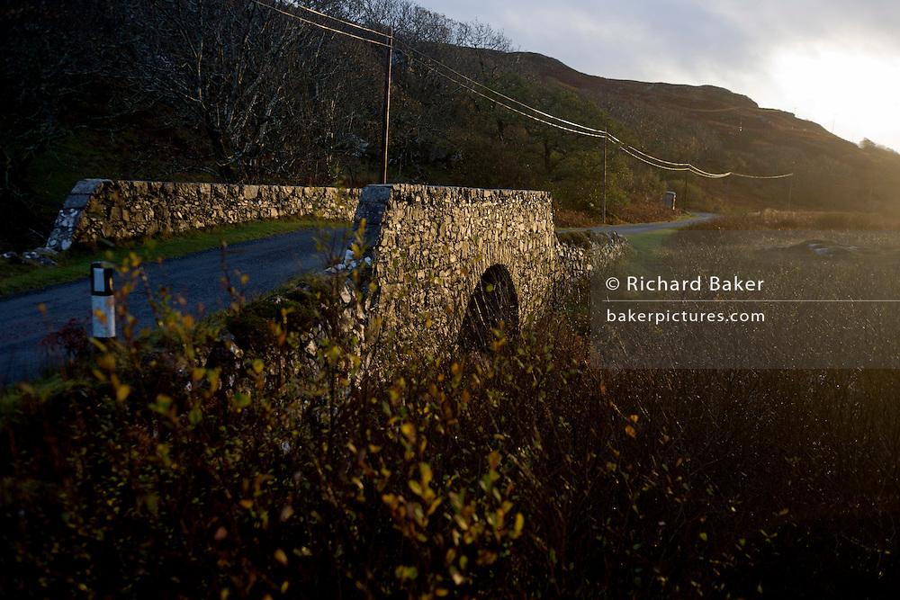 Stone bridge over the Allt an Eas River at Eas Falls, near Kilbrennan, Isle of Mull, Scotland.