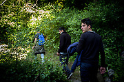 A small group of refugees, afraid to be followed by the police climbs the hill between Italy and France. Ventimiglia, Italy. April 2017. Federico Scoppa