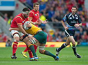 Twickenham, Great Britain, Wales', Scott BALWIN, stopped by Dean MUMM's tackle during the Pool A game, Australia vs Wales.  2015 Rugby World Cup,  Venue, Twickenham Stadium, Surrey, ENGLAND.  Saturday  10/10/2015.   [Mandatory Credit; Peter Spurrier/Intersport-images]