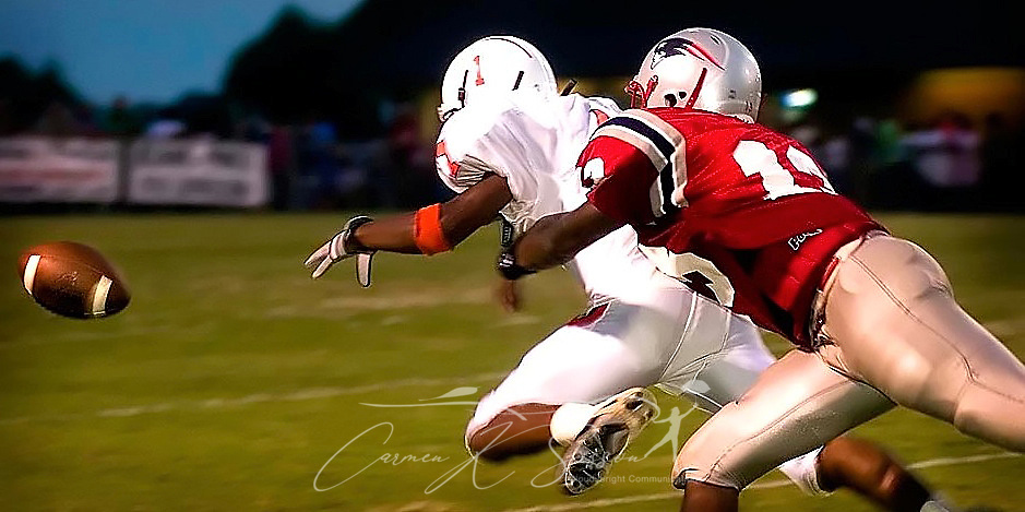Fayette High School's Sidney Cochran is tackled by Hillcrest High School's Ray Frierson as the pass goes incomplete Aug. 26, 2005, at Hillcrest. (Photo by Carmen K. Sisson/Cloudybright)