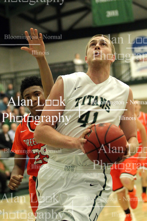 17 November 2015:  Trevor Seibring(41) gets inside and underneath for a close shot during an NCAA men's division 3 CCIW basketball game between the Greenville College Panthers and the Illinois Wesleyan Titans in Shirk Center, Bloomington IL