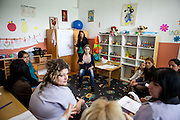 Romina Kajtazova - working as a paralegal for NGO Kham -teaching a workshop related to Roma health issues in a kindergarden located in the city of Vinica in Macedonia during  the European Immunization Week. Almost all attending women are from the local Roma community.