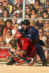 30 June 2004  Team Usa Catcher, Stacey Nuveman. Homeplate umpire is Nick Finck. Bloomington Lady Hearts vs. USA Olympic Softball Team.  Champion Field #1.  Normal Illinois