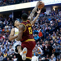 22 March 2017: Denver Nuggets guard Gary Harris (14) is blocked by Cleveland Cavaliers center Tristan Thompson (13) during the Denver Nuggets 126-113 victory over the Cleveland Cavaliers, at the Pepsi Center, Denver, Colorado, USA.