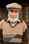 Pakistani man wearing a pakol or pakul hat worn typically by Pashtun people in Northern Pakistan.