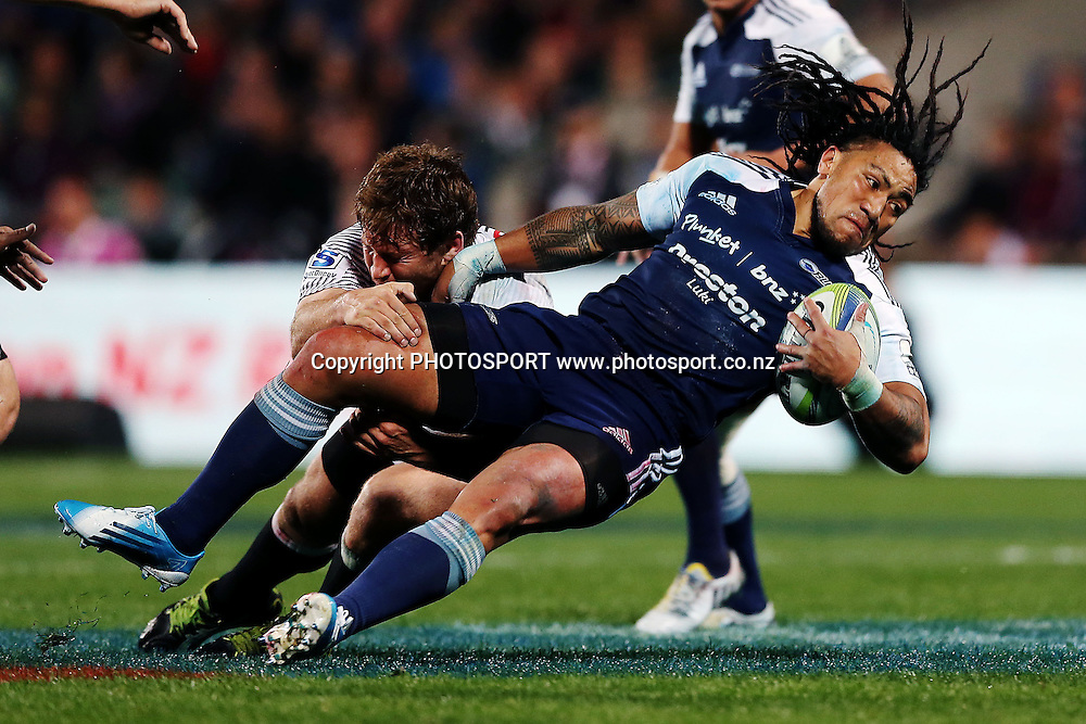 Ma'a Nonu of the Blues is tackled by Francois Steyn of the Sharks. Super Rugby rugby union match, Blues v Sharks at North Harbour Stadium, Auckland, New Zealand. Friday 23rd May 2014. Photo: Anthony Au-Yeung / photosport.co.nz