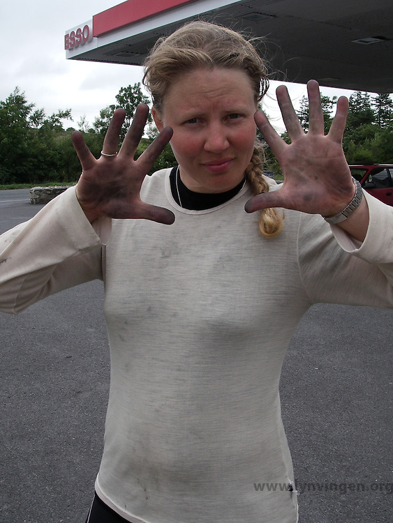 Girl have just fixed a puncture - dirty hands..................