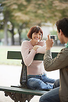 Couple Using Digital Camera in Park