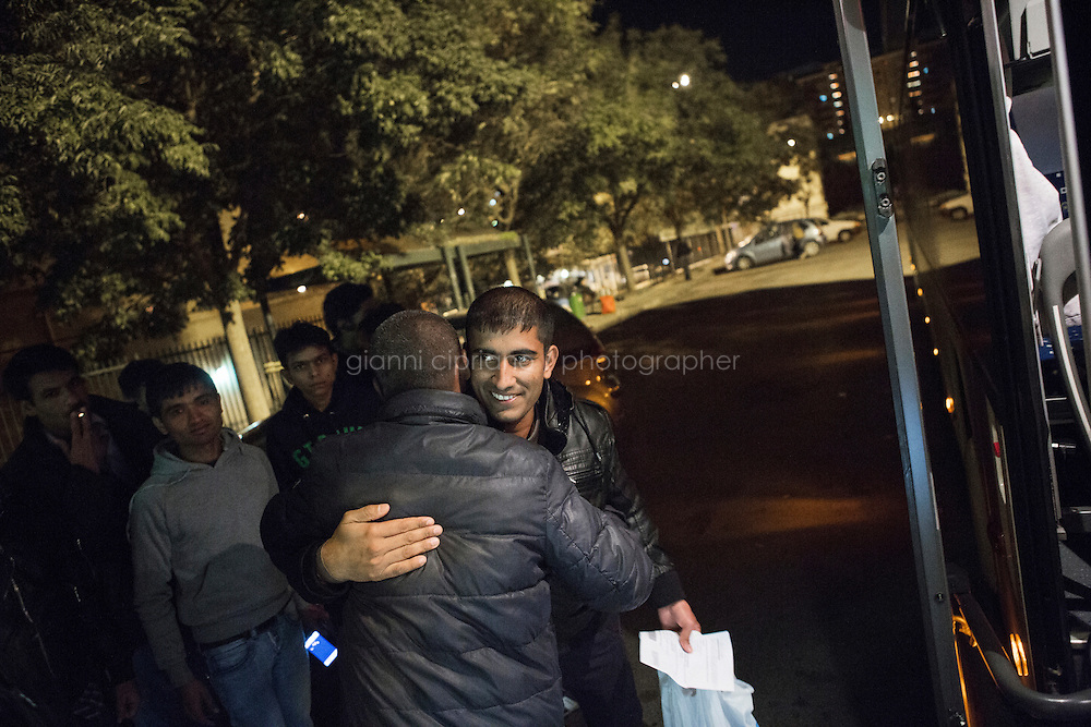 CALTANISSETTA, ITALY - 13 NOVEMBER 2014: A Pakistani asylum seeker says good-bye to friends as he leaves for Rome by bus, at the bus station in Caltanissetta, Italy, on November 13th 2014. After receiving either a refugee status, humanitarian or subsidiary protection, asylum seekers who decide to continue their journey outside Sicily take a bus to Rome, 900km away. <br /> <br /> To this date, the Pian de Lago CARA (Accommodation Centre for Asylum Seekers) hosts 491 asylum seekers, while 40 illegal immigrants are held in the CIE (Center for Identification and Deportation), before being deported.