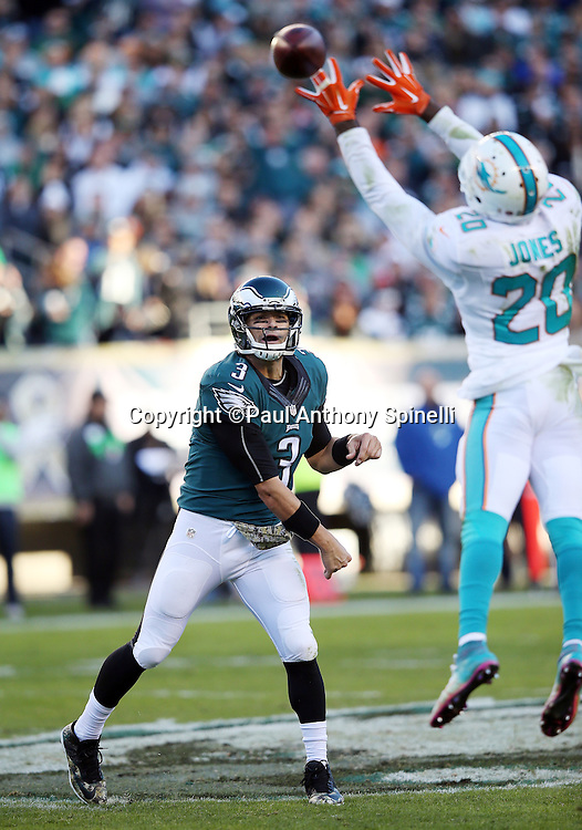 Philadelphia Eagles quarterback Mark Sanchez (3) throws a pass as Miami Dolphins strong safety Reshad Jones (20) leaps while trying to block it during the 2015 week 10 regular season NFL football game against the Miami Dolphins on Sunday, Nov. 15, 2015 in Philadelphia. The Dolphins won the game 20-19. (©Paul Anthony Spinelli)