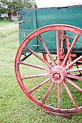 An old green wagon with a red wagon wheel. Missoula Photographer