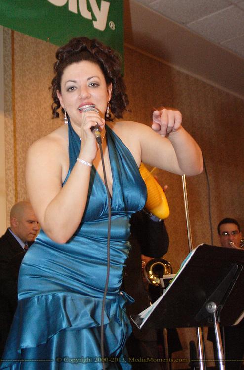 Gina Stough sang with Son del Caribe at the 17th Artemis Center Gala, Saturday night.