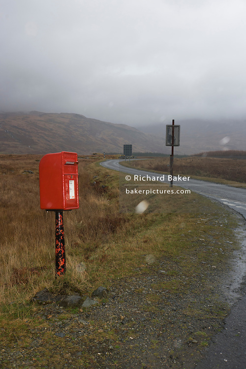 Post box at junction of B8035 and A849 roads near Pennyghael, Isle of Mull, Scotland.