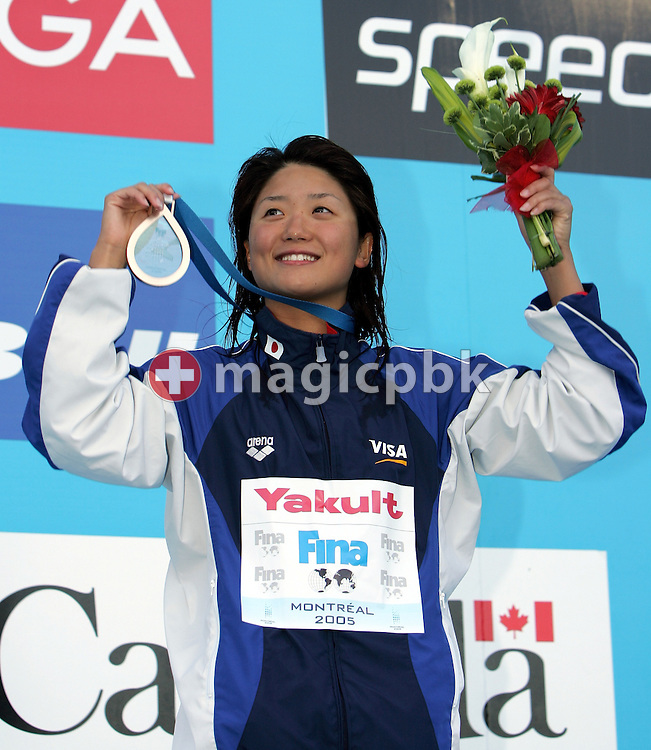 Japan's bronze medalist Reiko Nakamura holds up her medal during the victory stand ceremony of the 200m Backstroke at the FINA World Championships in Montreal, Canada,Saturday, 30 July 2005.  (Photo by Patrick B. Kraemer / MAGICPBK)