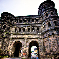 Built from sandstone in 186-200 AD, Trier's Black gate - Porta Nigra - is the largest Roman city gate for a walled city North of the Alps