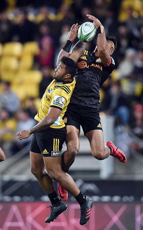 Hurricanes Vince Aso, left and Chiefs Solomon Alaimalo contest a high ball in the Super Rugby match at Westpac Stadium, Napier, New Zealand, Friday, April 13, 2018. Credit:SNPA / Ross Setford