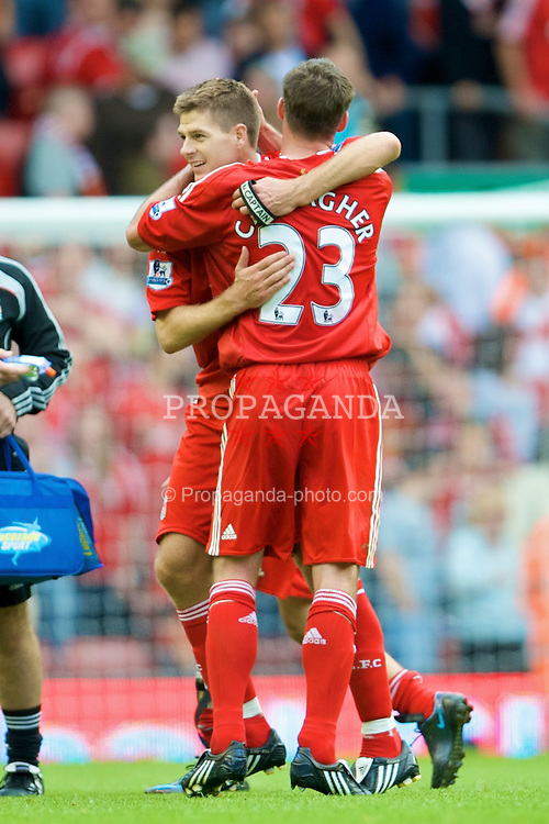 LIVERPOOL, ENGLAND - Saturday, August 23, 2008: Liverpool's match-winners captain Steven Gerrard MBE and Jamie Carragher celebrate their late 2-1 victory over Middlesbrough during the Premiership match at Anfield. (Photo by David Rawcliffe/Propaganda)